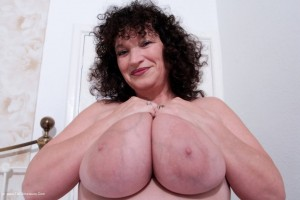 Busty wife Kim nude and rude